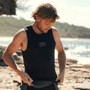 Picture of the Ocean and Earth Flame Thermo Vest and how it fits on a surfer. The vest is a black sleeveless top with white ocean and earth logo on the centre front. This is a vest you can wear under a wetsuit