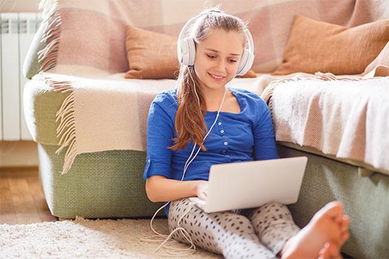 Girl Watching DVD on Computer