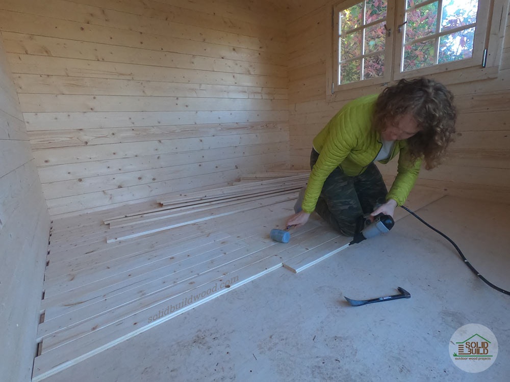 Shed floorboards installed over insulation and plywood