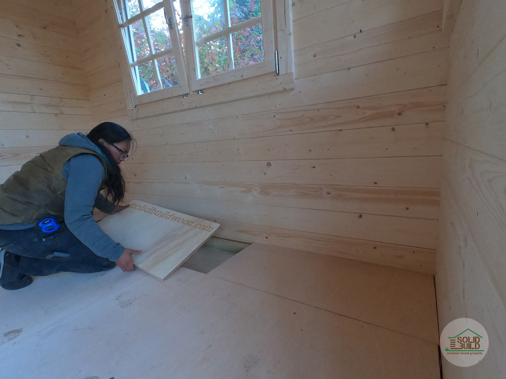 Shed floor insulation covered with plywood subfloor