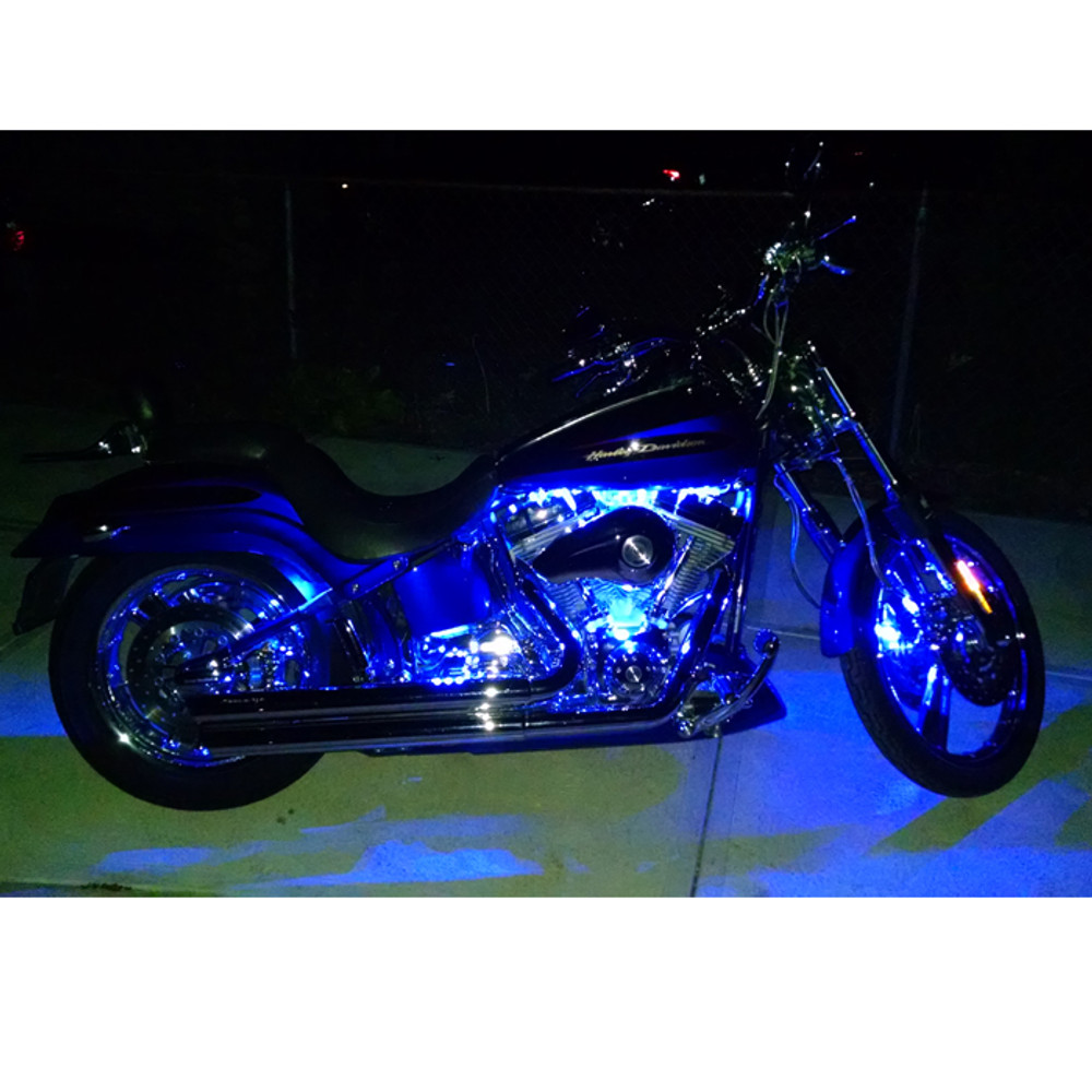 Single MEGA Stick on the inside of the front caliper and one installed each side on the inside of the rear fender.  Value series engine kit in blue lighting the engine on this Dyna.