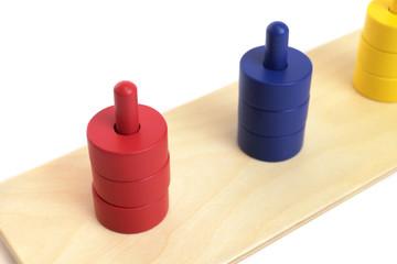 Colored Discs on Colored Dowels by Gonzagarredi Montessori