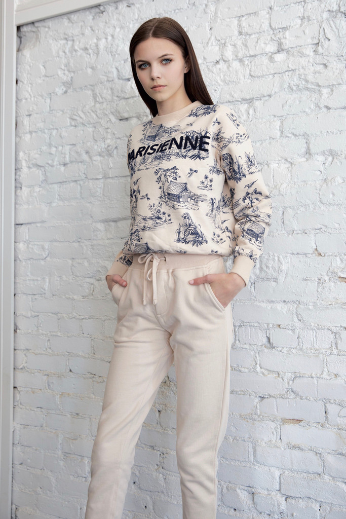 model wearing a small top paired with cream Joggers in size small