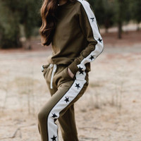 Olive Crewneck Features star panels on sleeves