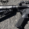 Right hand of rear portion of Cobra Tactical Professional CT-15 Carbine - Tough stock! Shows fire selection icons and retracted rear sight