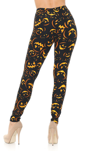 Rear view of our body-flattering Buttery Soft Evil Halloween Pumpkins Leggings, perfect for a festive fall outfit.