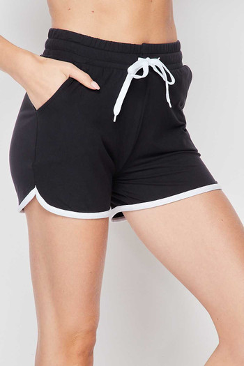 45 degree right side view of Black Wholesale Buttery Soft Drawstring Waist Plus Size Dolphin Shorts with Pockets