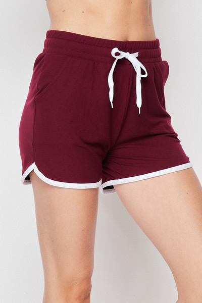 45 degree front/left view of Burgundy Wholesale Buttery Soft Drawstring Waist Plus Size Dolphin Shorts with Pockets