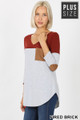 45 degree left side view of Fired Brick Wholesale Color Block V-Neck 3/4 Sleeve Plus Size Top with Front Pocket