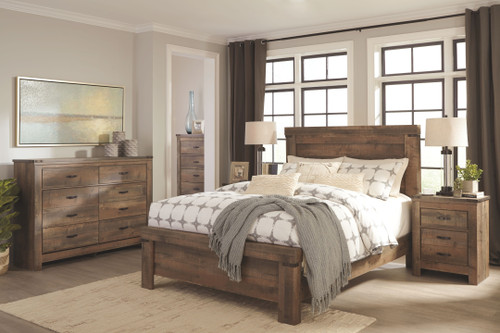 Trinell Brown 7 Pc. Dresser, Chest, King Panel Bed, 2 Nightstands