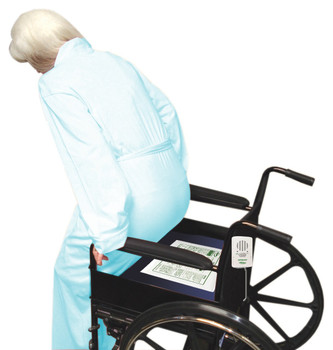 Chair Pad is placed under patient.  When patient removes pressure from the pad, the alarm sounds