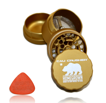 """Cali Crusher's *PREMIUM* Lineup! Homegrown! 4-Piece 'Pollenator' 1.85"""" Model.  Original 4-Way Quicklock technology, just a quarter turn to lock & open. Removable screen makes it easy to clean, upgrade and repair. Our original smooth rounded contour catch chamber, easy pollen access. Comes with a guitar pick scraper. Grooved edge for easy grip. Ultrasonically cleansed 6061-T6 Aerospace Medical Grade Aluminum Patented radial cut blades for maximum shredding: cuts one way, fluffs the other. New blade layout allows for a larger loading capacity. Neodymium rare earth magnets for superior closure, easily hold the grinder from the lid. Blades/Teeth covered under a lifetime warranty!"""