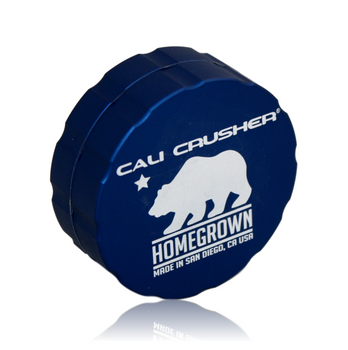 """Cali Crusher's *PREMIUM* Lineup! Homegrown! 4-Piece 'Pollenator' 1.85"""" Blue Color.  Original 4-Way Quicklock technology, just a quarter turn to lock & open. Removable screen makes it easy to clean, upgrade and repair. Our original smooth rounded contour catch chamber, easy pollen access. Comes with a guitar pick scraper. Grooved edge for easy grip. Ultrasonically cleansed 6061-T6 Aerospace Medical Grade Aluminum Patented radial cut blades for maximum shredding: cuts one way, fluffs the other. New blade layout allows for a larger loading capacity. Neodymium rare earth magnets for superior closure, easily hold the grinder from the lid. Blades/Teeth covered under a lifetime warranty!"""
