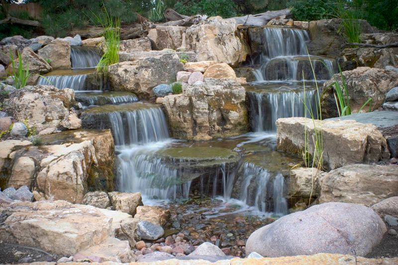 A Pondless Waterfall Will Enhance Your Backyard