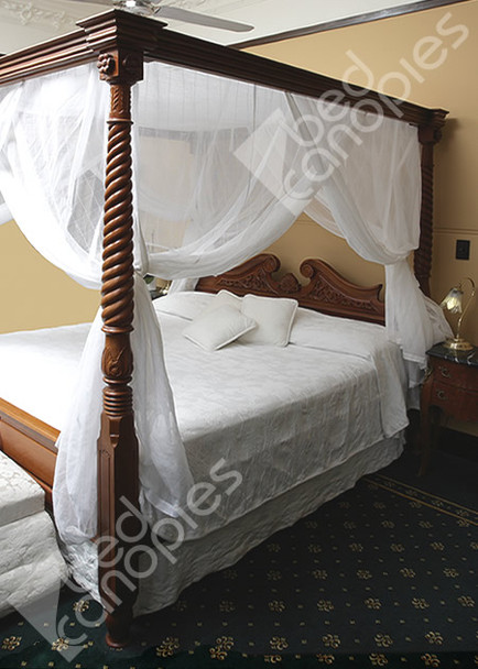 Canopy bed curtain on poster bed