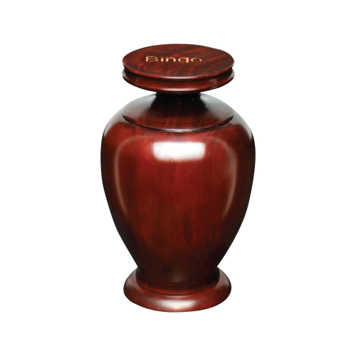 This beautiful mahogany finish urn is a perfect way to memorialize your beloved friend.  The top of the urn can be engraved.  This urn is estimated to hold the remains of a pet up to  80 lbs.