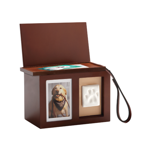 """A perfect way to memorialize your beloved pet with a box that can hold not only remains, but could also hold their leash, toys, collars, etc. This hand-finished product comes with a mess-free impression material so making and displaying your pet's paw print is a cinch. Holds a 4"""" x 6"""" or 5"""" x 7"""" photo. Interior capacity is 448 cubic inches.  Will hold up to a 300 lb. pet."""