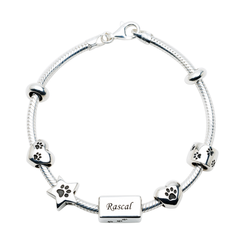 The NozyPaws Bracelets, made in Italy, are snake chains, 2.8 mm in gage, with 2 removable stoppers and a big lobster closure.  Does not include charms.  Charms may be purchased separately.