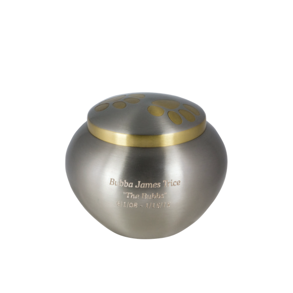 This urn is handcrafted in brass and electroplated. It is accented with paw prints on the lid. It has a threaded lid for secure closure and will hold pet remains for pets up to 30 lbs (small) or up to 60 lbs. (large).   This product can be engraved.
