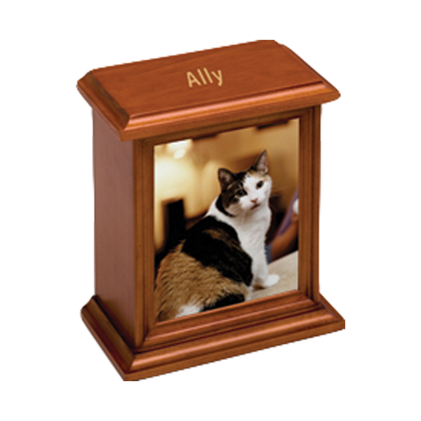 A cherry stain wood urn with a vertical photo display. This product is engravable and is estimated to hold the remains of a pet up to 50 lbs. (small) or up to 150 lbs. (large).
