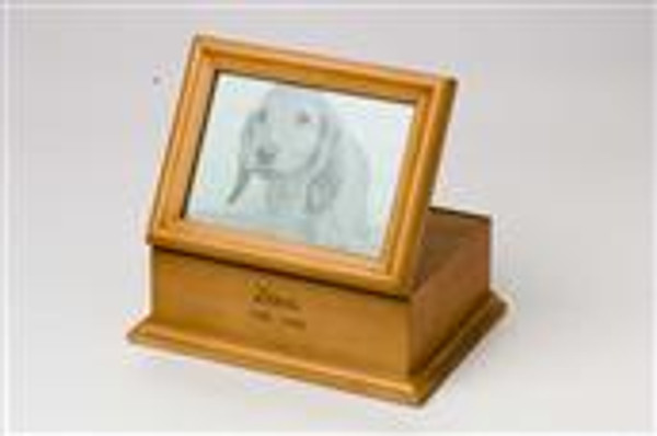 A maple finish wood urn with an attached photo display. This product is engravable and is estimated to hold the remains of a pet up to 150 lbs.