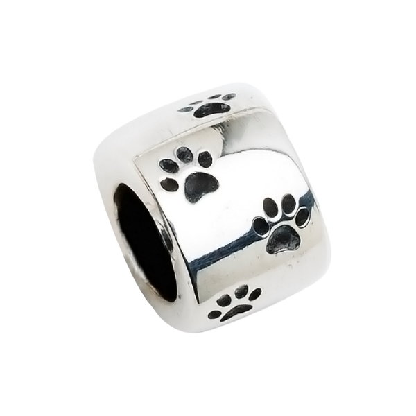 A beautiful sterling silver barrel charm with paw prints to honor your beloved pet in a unique way.  Fits any 2.8 mm bracelet, including the PR109B NozyPaws Bracelet.  Does not hold cremated remains.
