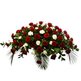 Casket spray of medium size with red roses and white carnations for funeral and sympathy occasion for delivery in Vancouver, Burnaby , Coquitlam and Port Moody.