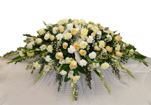 Vancouver Funeral Flower Casket Spray with white and peach colour flowes | Adele Rae Florist | Burnaby Florist