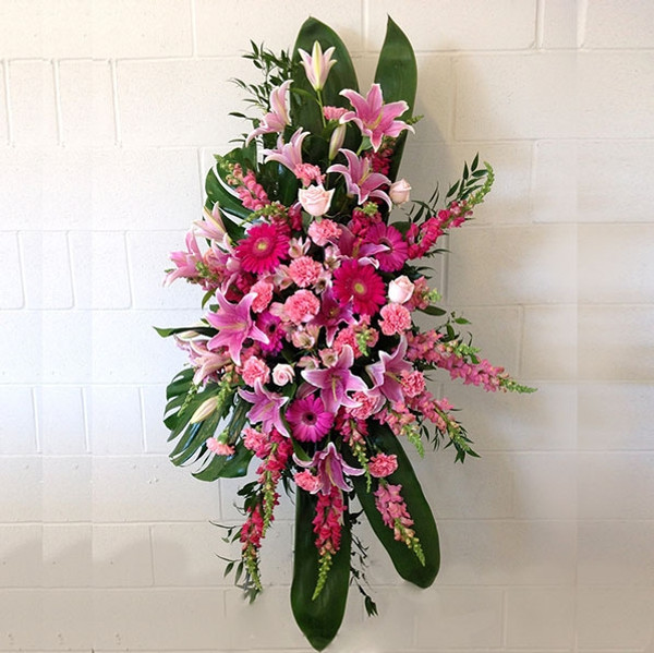 Funeral flower standing spray with pink color flowers