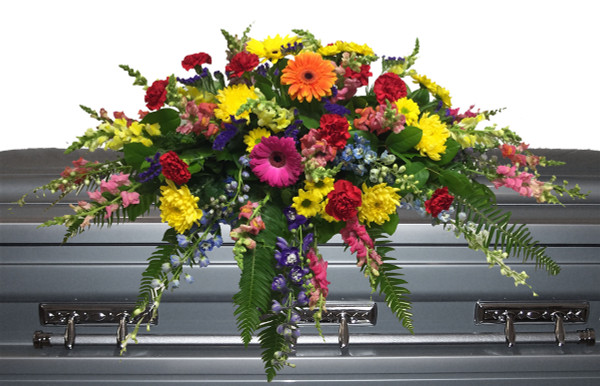 Funeral flower casket spray with assorted colourful flowrs