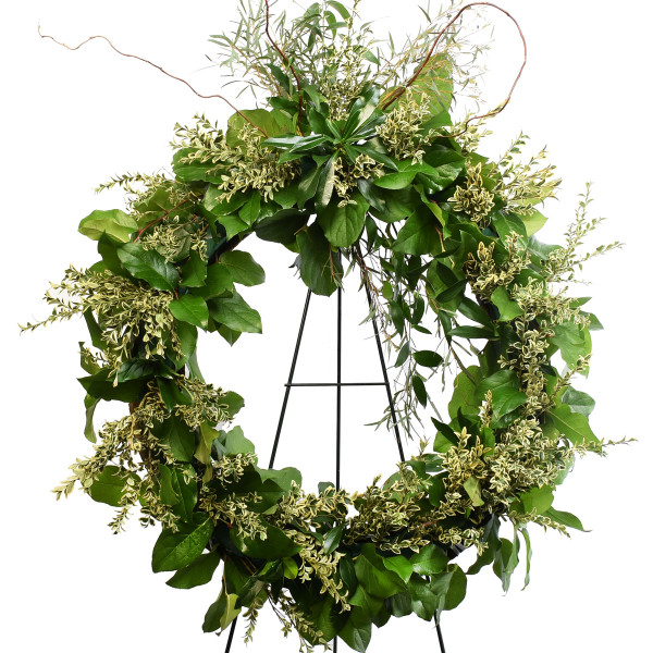 24 inch funeral wreath made with greeneries.