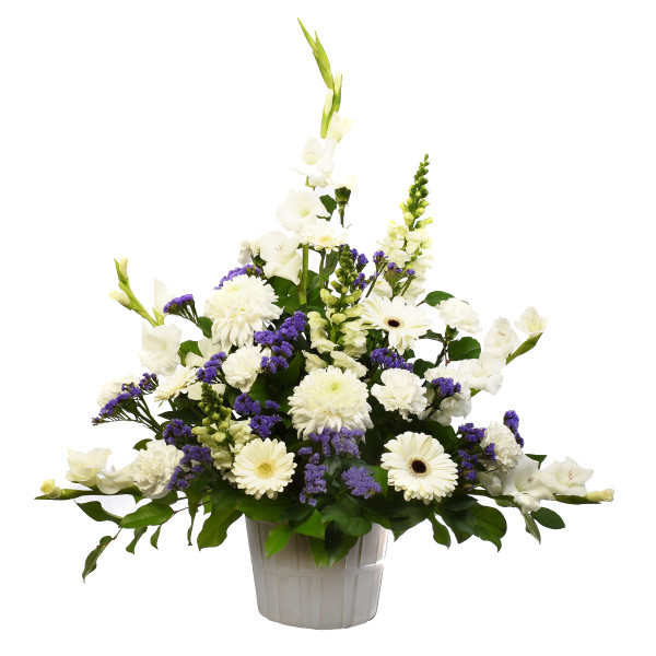 A sympathy white flower arrangement for home