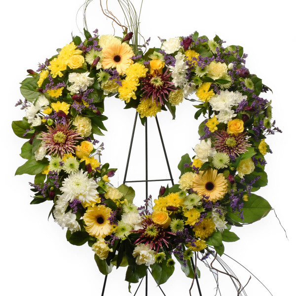 Heart shaped funeral wreath tribute with a mix of fresh flowers