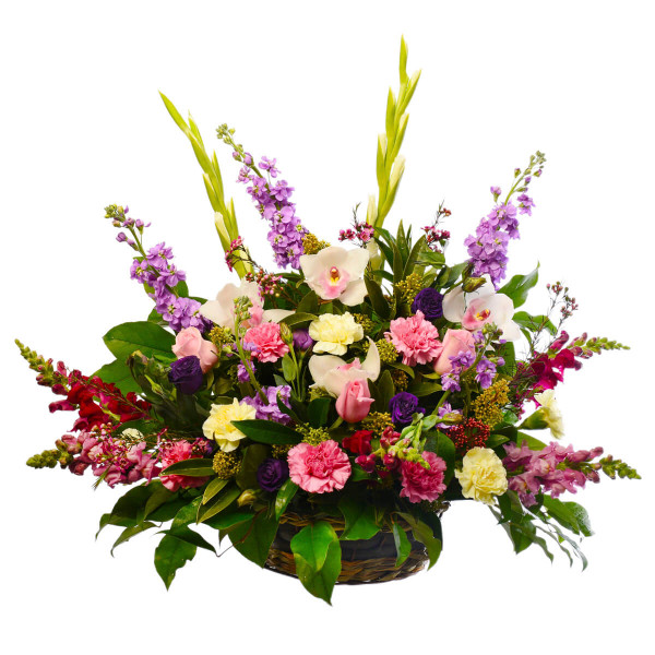 Flower arrangement in a basket with mixed flowers