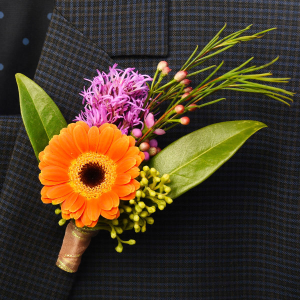 Mini gerbera flower boutonniere pin for wedding or prom in Vancouver.