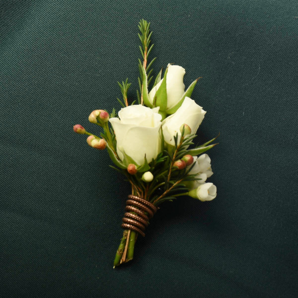 White spray rose beautiful boutonniere for a wedding from Vancouver Florist Adele Rae Florist.
