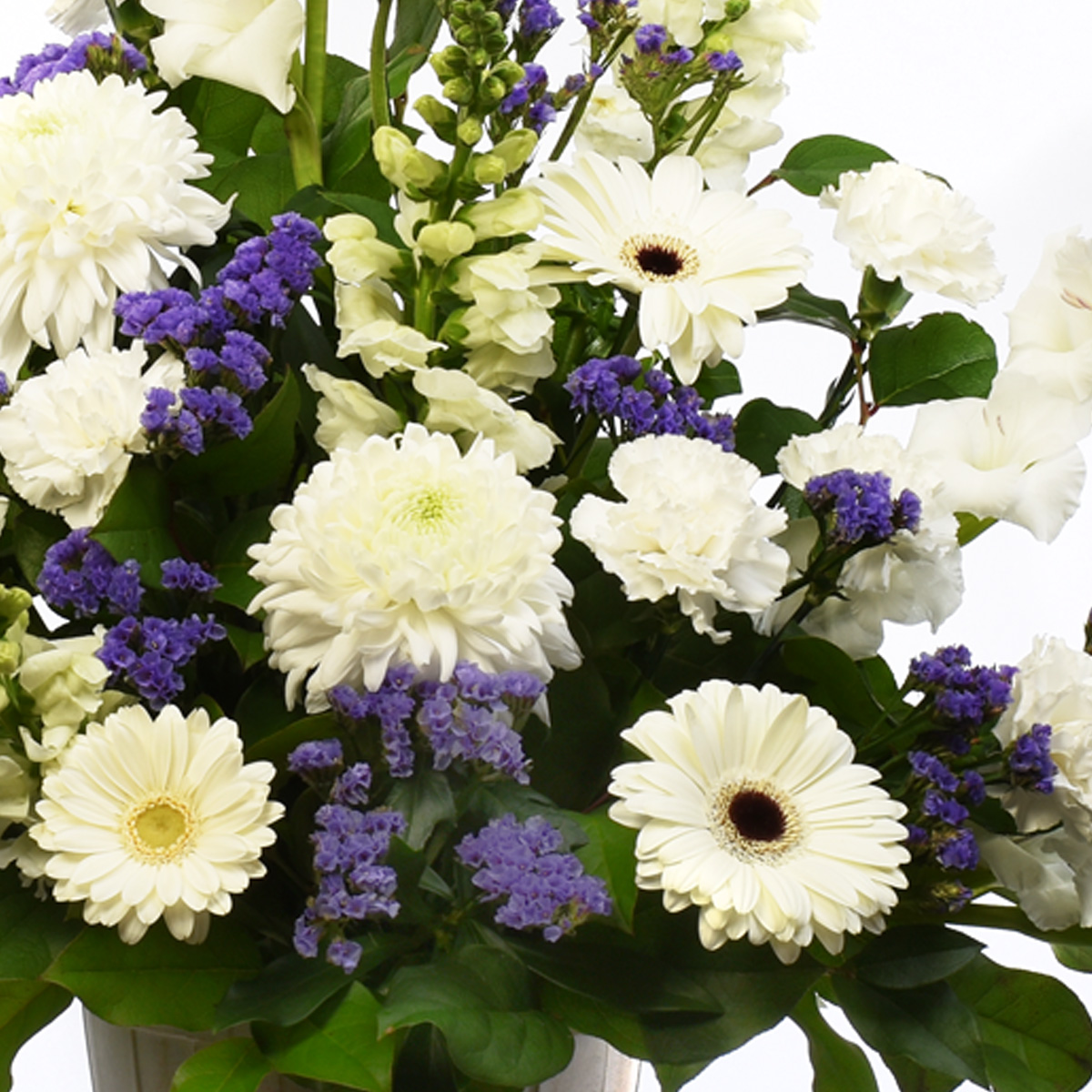 Sympathy flower design for home with white flowers like gladiolas
