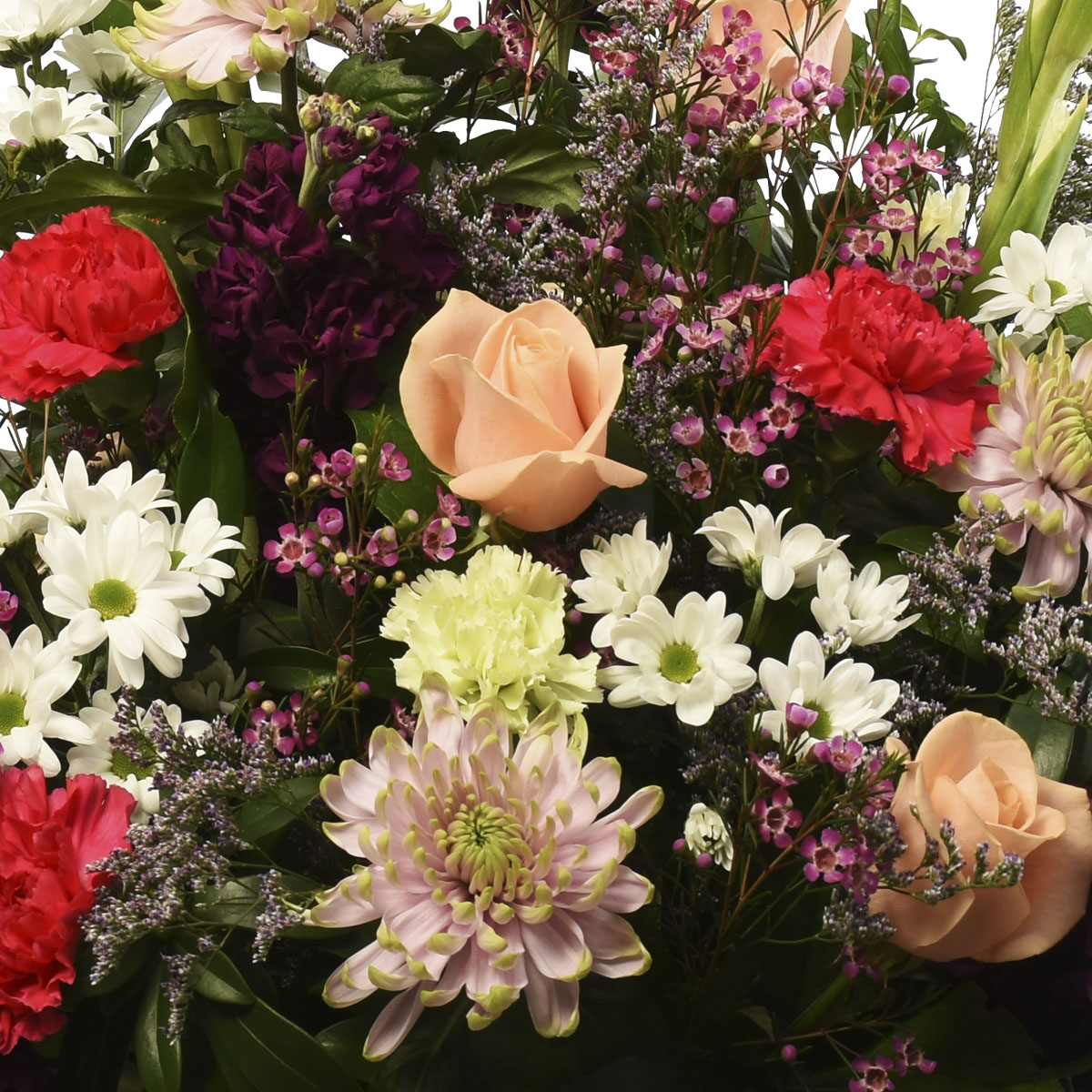 Floral design in a basket with a selection of mix flowers from Adele Rae