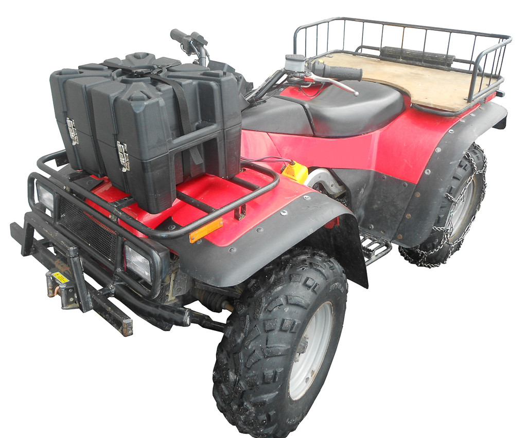 This case includes straps to attach to most ATV racks.