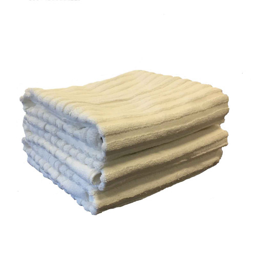 New White Terry Bath Mats, shown in a stack
