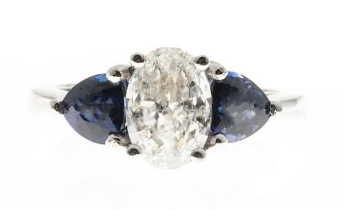 Vintage Estate Oval Diamond and Trillion Cut Ceylon Vivid Sapphire Platinum Ring