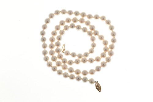 22 inch cultured Akoya 6.5mm 14k yellow gold Pearl necklace