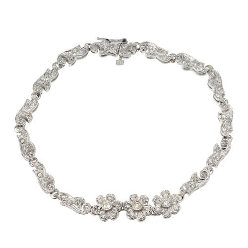 .68 Carat Diamond White Gold Swirl Link Flower Gold Bracelet