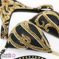 Black and gold figure competition suit
