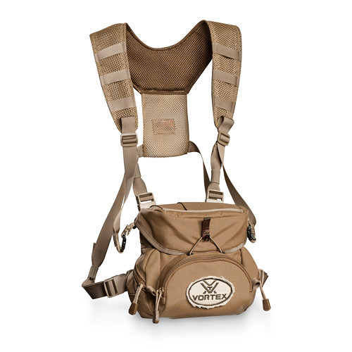 The full coverage lid secures with a fine diameter bungee and rigid nylon tab. A generous front zippered pouch with shell loops is perfect for larger items such as rangefinders, a knife, fire starters, etc. The side pockets, zippered pocket on the rear face, and elastic sleeves on the top hold additional items.