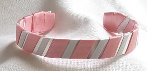 Show off your breast cancer support by wearing our Pink and White Ribbon Cuff Bracelet.  Aluminum base with creatively decorative wrapped ribbon.  Perfect for individual inspiration, school groups/events, donation requests and for whatever your creative imagination brings.
