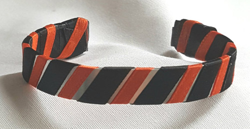Show off your School Colors by wearing our Orange and Black Ribbon Cuff Bracelet.  Aluminum base with creatively decorative wrapped ribbon.  Perfect for individual inspiration, school groups/events, donation requests, holiday parties/runs and for whatever your creative imagination brings.