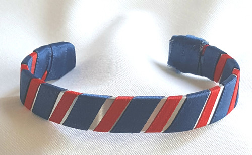 Show off your School Colors by wearing our Navy and Red Ribbon Cuff Bracelet.  Aluminum base with creatively decorative wrapped ribbon.  Perfect for individual inspiration, school groups/events, donation requests and for whatever your creative imagination brings.