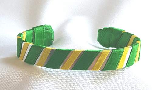 Show off your School Colors by wearing our Green and Yellow Ribbon Cuff Bracelet.  Aluminum base with creatively decorative wrapped ribbon.  Perfect for individual inspiration, school groups/events, donation requests and for whatever your creative imagination brings.