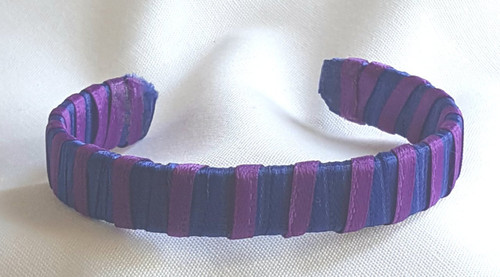 Show off your School Colors by wearing our Blue and Purple Ribbon Cuff Bracelet.  Aluminum base with creatively decorative wrapped ribbon.  Perfect for individual inspiration, school groups/events, donation requests and for whatever your creative imagination brings.